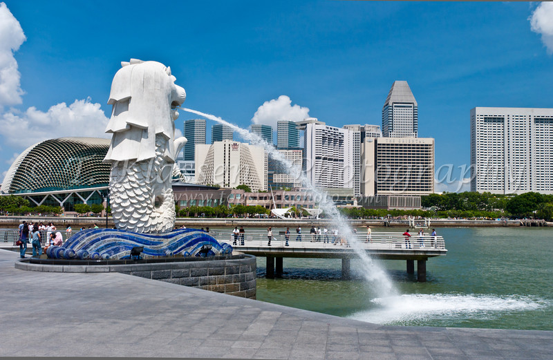 The Singapore skyline with the Merlion fountain and hotels of Marina Bay, East Asia.