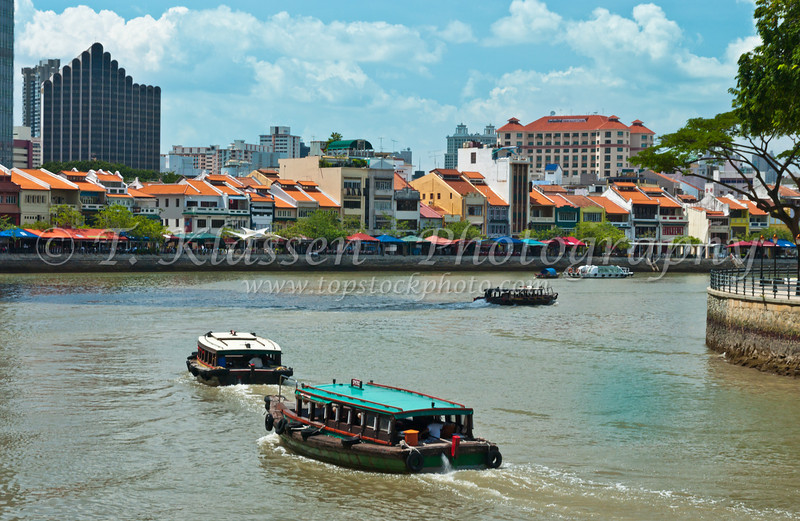 The Singapore River, shops houses and bumboats, East asia.