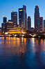 The buildings of the Singapore skyline with reflections at dusk, East Asia.