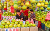 Outdoor fruit market selling pomellos in Chinatown, Singapore, East Asia.