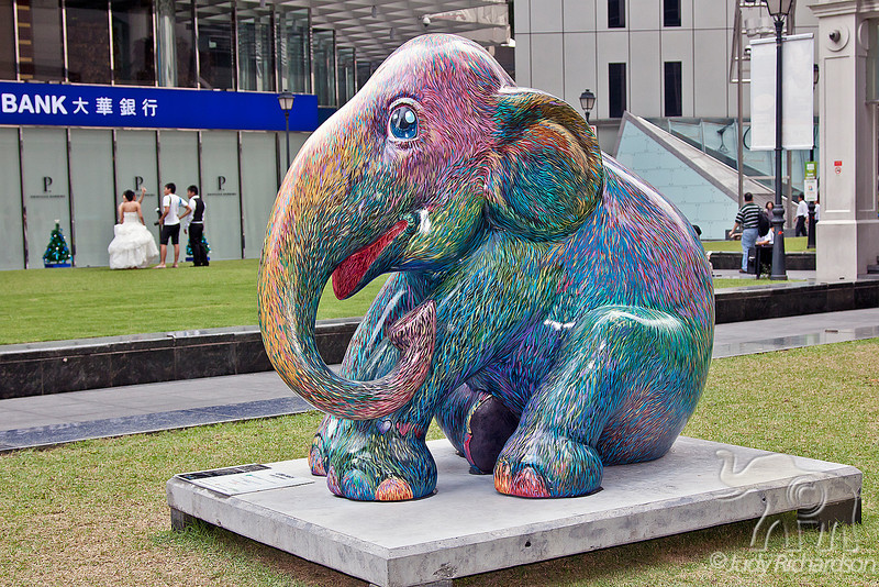 Colorful elephant statues are everywhere around Singapore. This is a particular favorite with wonderful colors...but note the bride and groom at the back of the photo.