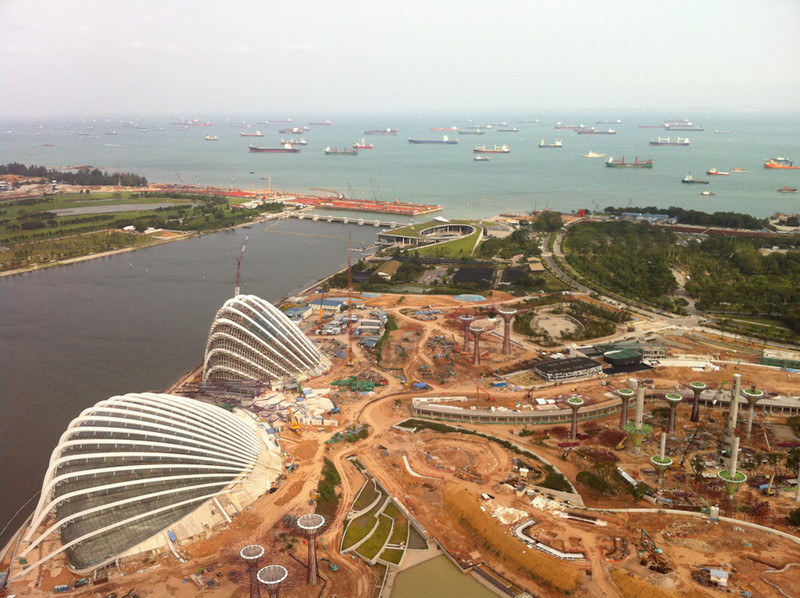The construction works going on next to the Marina Bay Sands and cargo ships waiting offshore