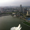 "The roof of the Marina Bay Sands ArtScience Museum and the Bay with the Esplanade Theatre (""the Durian"") in the background"