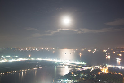 Moon over the Singapore Strait, seen from the Marina Bay Sands Skypark