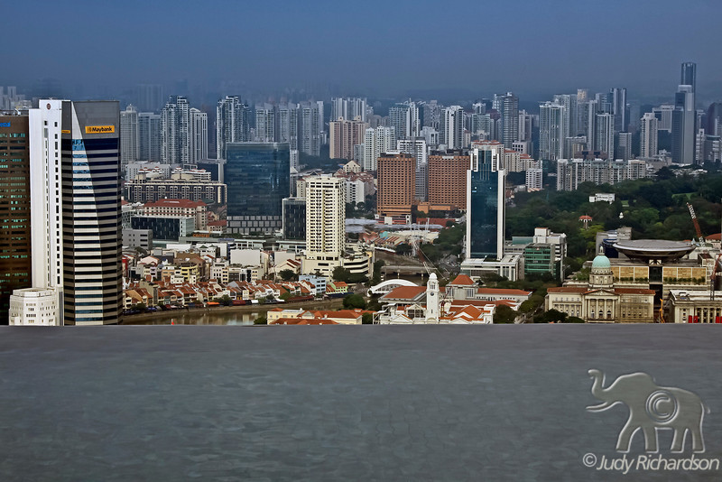 """Singapore View from the Marina Bay Sands Hotel """"Boat Deck"""" with the infinity pool in the foreground."""