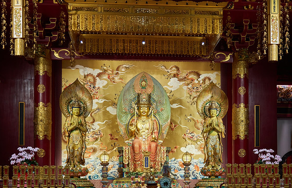The gilded and ornate interior of Buddha Tooth Relic Temple and Museum in the Chinatown district of Singapore