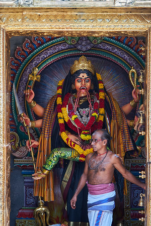 """Closing the door to a temple inside the Sri Veeramakaliamman Temple in the district of Little India, dedicated to the Hindu goddess Kali, """"fierce embodiment of Shakti and the god Shiva's wife, Parvati"""""""