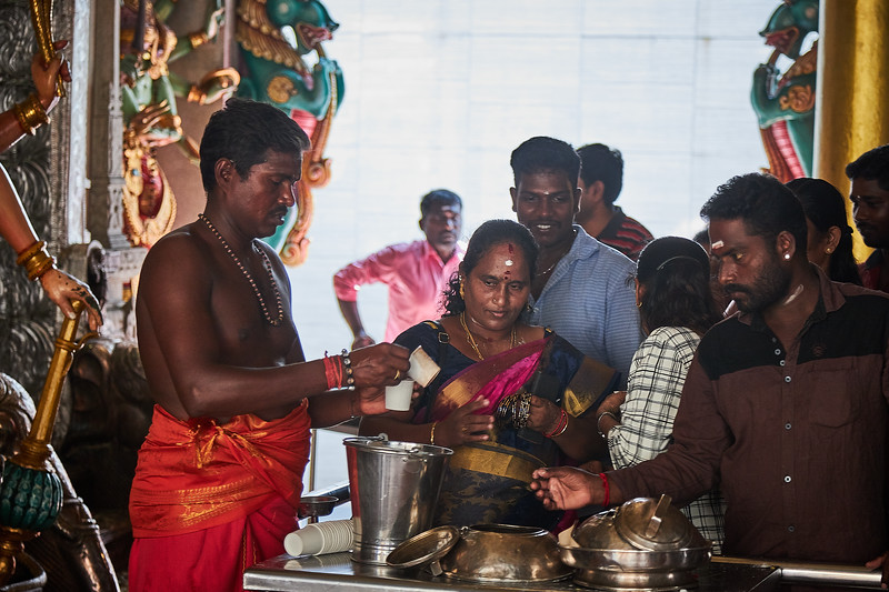Queing for a cup in the  Sri Veeramakaliamman Temple in the district of Little India