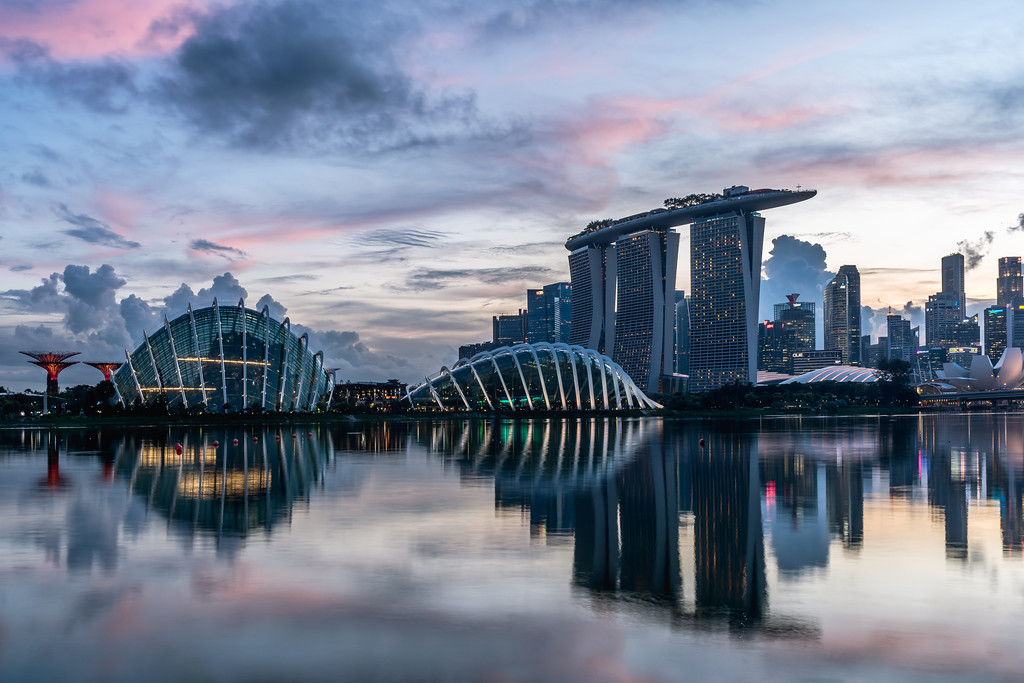 View of Gardens by the Bay and Marina Bay Sands at dusk.