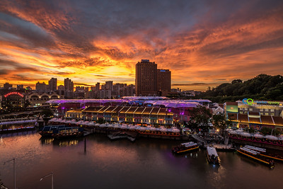 Clarke Quay comes alive at sunset.