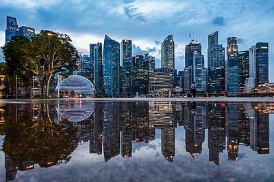 Reflection of Singapore's Marina Bay skyline.