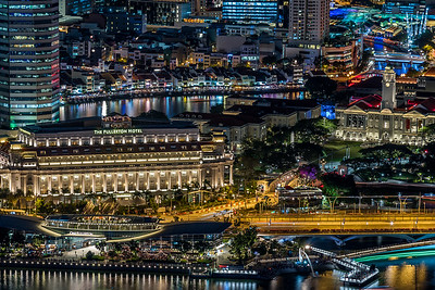 View of The Fullerton Hotel, Victoria Concert Hall, Boat Quay and Clarke Quay at night.