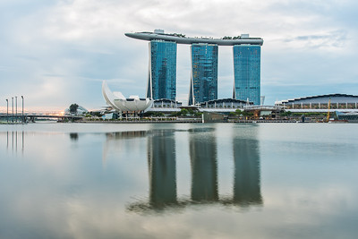 View of Marina Bay Sands and ArtScience Museum at sunrise.