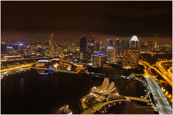 Singapore skyline at night, view from The Marina Bay Sands