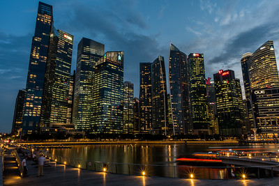 View of Marina Bay Financial Centre at dusk.