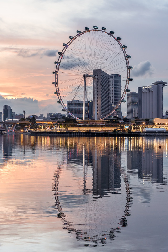 Reflection of Singapore Flyer.