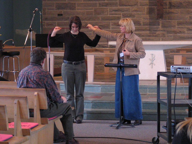 Sherri Watters presented a workshop on nutrition. Here she's demonstrating muscle stretching techniques on Delinda Kinney.