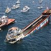 "By DAVID RAINER<br /> Alabama Department of Conservation and Natural Resources<br />  <br /> Weather permitting, The Wet Willie Band will be rocking when David Walter and his crew from Walter Marine open the valves on a 271-foot coastal freighter and send it to the bottom of the Gulf of Mexico about 20 miles south of Orange Beach.<br /> <br /> The freighter, which officially will be rechristened ""The LuLu"" Friday afternoon at a ceremony at LuLu's Homeport restaurant on the Intracoastal Canal in Gulf Shores, will be a new tack in reef deployment off the Alabama Gulf Coast with the focus on the recreational diving community.<br /> <br /> ""We've built reefs primarily for fishing,"" said Chris Blankenship, Director of the Alabama Marine Resources Division (MRD). ""Diving has just been a secondary use for the reefs we've put out.""<br /> <br /> Blankenship said Walter (aka Reefmaker) saw the cargo ship for sale at auction and asked MRD to help him with the cost of hauling the ship from Miami, preparing the ship for deployment and sinking the vessel in the Gulf. The total price tag was $500,000.<br /> <br /> ""We told David we didn't have $500,000 to do it,"" Blankenship said. ""We thought it was a great idea, but we didn't have all the money. David went ahead and purchased it anyway and towed it to his place on the Intracoastal Canal. The engine and a lot of stuff had been removed in Miami.""<br /> <br /> The ship turned out to be the impetus to put together the Alabama Gulf Coast Reef and Restoration Foundation, a non-profit formed to assist in artificial reef deployment.<br /> <br /> Blankenship said the Gulf Coast Convention and Visitors Bureau, Gulf Coast Chamber of Commerce, MRD, dive shops along the Alabama coast, Orange Beach Fishing Association and Walter Marine partnered with the foundation to raise the funds necessary to deploy ""The LuLu.""<br /> <br /> ""Marine Resources Division offered the first $100,000,"" Blankenship said. ""We had that available. They said if they had some money it would be easier to raise the rest of the money.<br /> <br /> Vince Lucido, president of the reef foundation, said the Baldwin County Commission kicked in $200,000, while the cities of Orange Beach and Gulf Shores added $50,000 each.<br /> <br /> Then up stepped Mac McAleer, former executive with Krispy Kreme who owns Homeport Marina. McAleer made a large donation to surpass the fundraising goal. McAleer's donation earned him naming rights. He chose The LuLu, the nickname for Lucy Buffet, McAleer's business partner and name of Buffet's restaurant adjacent to McAleer's marina.<br /> <br /> ""They raised the money in six months,"" Blankenship said. ""The number of entities that came together to work on this was very impressive. It's to benefit the whole Alabama coastal community. We hope to bring in some dive groups and additional tourism.""<br /> <br /> The ship is a 271-foot coastal freighter, formerly used to carry cargo for relatively short trips to coastal areas and the Caribbean. The ship was mothballed and sold at auction. The main engines, generators, drive shafts, piping and electrical components were removed to make it eligible for a reef permit.<br /> <br /> ""They had a need to place the vessel within 20 miles of the shore for it to be effective for dive groups,"" Blankenship said. ""We are required to have 50 feet of clearance above the reef. The vessel is about 55 feet high, so we were going to put it in 110 feet of water. The only problem was that you have to go farther than 20 miles out to get to 110 feet of water.<br /> <br /> ""So we got them to cut five feet off the top of the vessel. There was a rail and a smokestack that could be removed. We were able to work with the community to get what it needed. That way, we were able to find a place in 105 feet of water that was within that 20 miles. We also worked with the charter boat captains to find a suitable area. They knew of a trench that we could put it in to ensure we had that 50 feet of clearance.""<br /> Blankenship said because of the clearance, the reef will not be buoyed. Coordinates will be published in the MRD's reef guide.<br /> <br /> The ship will be towed down the Intracoastal Canal on Friday, May 24, to LuLu's restaurant on the canal where the rechristening party will be held. The vessel will start its journey to the Gulf of Mexico on Saturday. McAleer plans to have a barge with Wet Willie aboard for an hour-long concert as the vessel slips below the surface.<br /> <br /> ""They'll have to go out past Fort Morgan and then tow it south of Orange Beach,"" Blankenship said. ""The ship will be on site Sunday morning. There will be a couple of charter boats out there, and private boats can come and watch. Then David Walter and his crew will open several valves he's installed and the ship will start to sink. A couple of hours later, hopefully it will be on the bottom. This will be the first intact ship that we've sunk in our reef zones.""<br /> <br /> Blankenship and Lucido said the Oriskany, the aircraft carrier that was deployed off Pensacola, was the example followed for this project.<br /> <br /> ""The Oriskany has brought in a lot of dive dollars into northwest Florida,"" Blankenship said. ""We're hoping this ship and others we add will do the same and diversify our economy from just catching red snapper to other non-consumptive recreation.""<br /> <br /> Lucido said the current project brought about the formation of the foundation, but there's a great deal more in store, especially with seed money of $150,000 remaining from their fundraising efforts.<br /> <br /> ""We felt like there would be other projects we would like to do in the future to complement what DCNR (Alabama Department of Conservation and Natural Resources) is doing,"" said Lucido of Krebs Engineering in Orange Beach. ""We want to sink two more ships to increase the balance in the area as far as tourist attractions. We want to do some snorkel reefs like the ones in the Florida Panhandle.<br /> <br /> ""I used to be a dive operator many years ago. I still do a lot of diving. When I was teaching, we'd have to go to Pensacola or Panama City. We have the same water they have. Several of us felt that diving is under-promoted in Alabama. That was one of the purposes of this reef is to increase the awareness of the great diving opportunities we have here.<br /> <br /> Blankenship said he expects the new reef will be available for diving very soon after deployment. Safety divers will check the wreck and diving will be allowed when given the ""all clear."" Anglers will also be able to fish the reef when divers are not submerged, adding to the already bountiful reef program off Alabama.<br /> <br /> ""There's no doubt we have the best reef-building program in the country,"" Blankenship said. ""We have 1,200 square miles of reef zones. About 17,000 reefs are deployed in the zones. It started back in the 1950s. The Liberty ships went down in the 70s. Bridge rubble from Dauphin Island Bridge went down in the 80s, and the tanks (Tanks to Reefs) went down in the 90s. Tensaw Bridge rubble and pipes and culverts (Roads to Reefs) have been deployed. Then there are 1,000 pyramids that were put down by the Red Snapper World Championship. So all that material has been put out there logically and spread around the whole area. That gives us the best reef fishing in the world.<br /> <br /> ""Now we're moving into sinking ships that will offer great diving opportunities off Alabama.""<br />  <br /> PHOTOS: The 271-foot coastal cargo ship rechristened The LuLu will be towed about 20 miles into the Gulf of Mexico over the weekend and will be sunk as the first reef in Alabama's extensive artificial reef zones with recreational divers in mind. Weather permitting, a barge with The Wet Willie Band will be on site for entertainment as the vessel sinks."