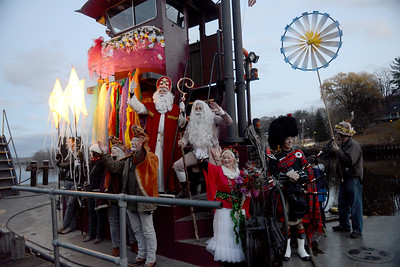 """Tania Barricklo-Daily Freeman                      Sinterklaas , who was joined by Rip Van Winkle this year, waves from the tug docked at the Hudson Rver Maritime Museum , before setting off down the Rondout Creek to """"Holland""""."""