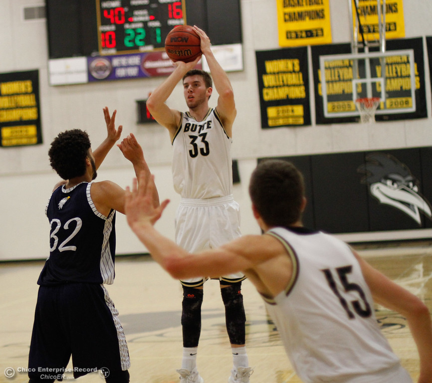. Butte College\'s Brandon Dozier goes up for the three pointer over Siskiyous\'s Deontrey Fuller during a men\'s basketball game January 23, 2017 at Butte College in Oroville, California. (Emily Bertolino -- Enterprise-Record)