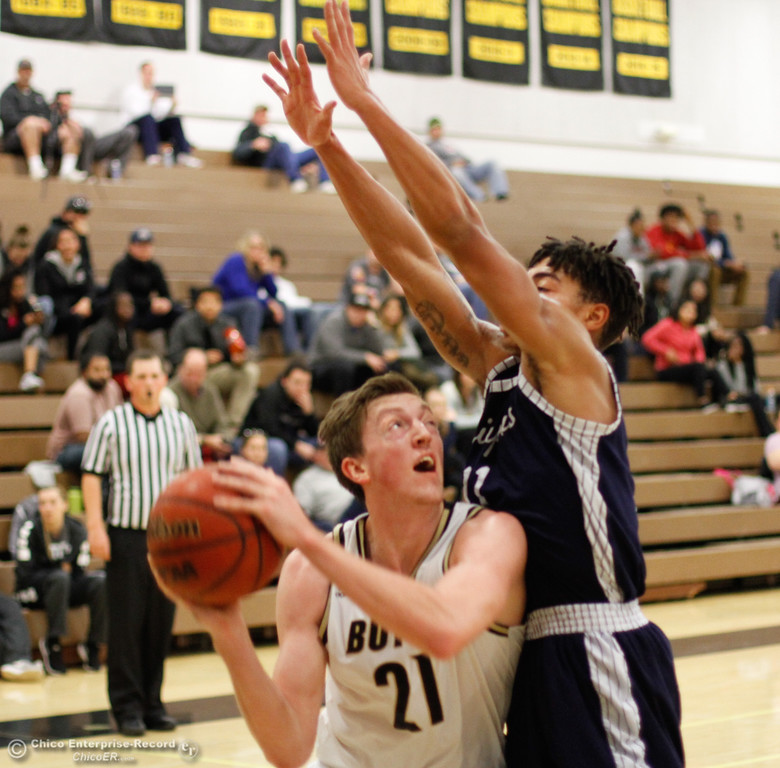 . Butte College\'s Josiah Wood looks to shoot over Siskiyous\'s Juan Parrilla during a men\'s basketball game January 23, 2017 at Butte College in Oroville, California. (Emily Bertolino -- Enterprise-Record)