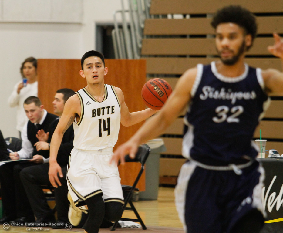 . Butte College\'s John Moscoso dribbles down court during a men\'s basketball game against Siskiyous January 23, 2017 at Butte College in Oroville, California. (Emily Bertolino -- Enterprise-Record)