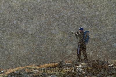 Fotograf i tett snøvær