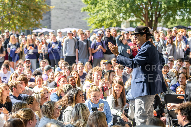 The Campus Ministry USA, Brother Jed, aggressively preaches in front of a crowd before Sister Cindy engages. Their open-air preaching ministry is concentrated on college campuses. Jed and Cindy engage in confrontational preaching with students passing by in Bosco Plaza on Oct 11, 2021. (Dylan Connell   Collegian Media Group)