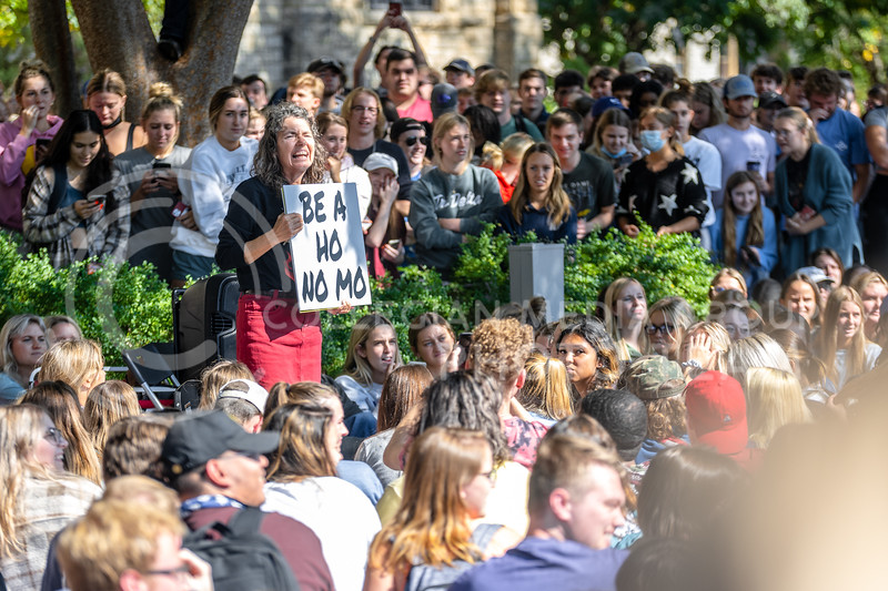 The Campus Ministry USA, Cynthia D. Lasseter Smock (Sister Cindy), aggressively preaches in front of a crowd. Their open-air preaching ministry is concentrated on college campuses. Jed and Cindy engage in confrontational preaching with students gathering at Bosco Plaza on Oct 11, 2021. (Marshall Sunner   Collegian Media Group)