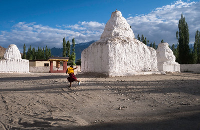 Skarma Chuksit plays in the midst of ancient stupas, near the Chattnyanling nunnery in Nyerma  village