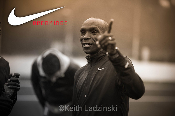 Eliod Kipchoge conversing with his fellow runners about race logistics during the Nike B2 event. B2 is a race where 3 top marathon runners attempt to run a marathon in 2 hours, an extremly ambitious endevour and testiment to human drive and ability.