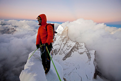 Exhausted, Renan Ozturk contemplates the long descent after making the summit. The top is only half way.