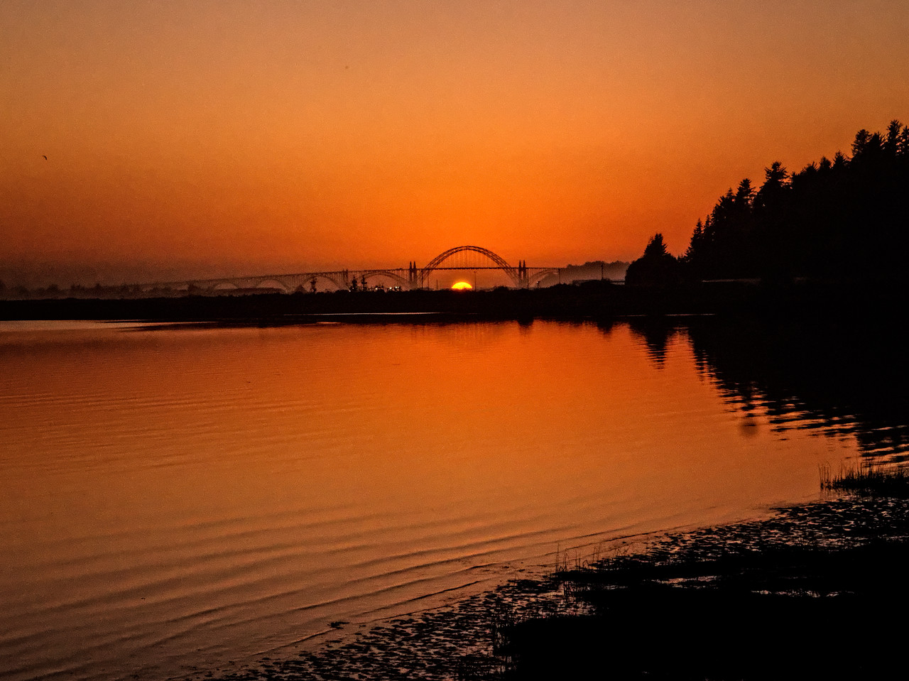 Sunset behind Yaquina Bay Bridge