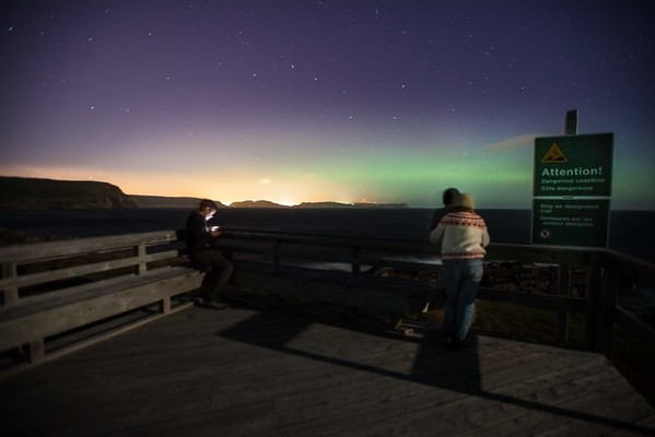"""Curtis Jones 2012 """"Cape Spear, Newfoundland. Completely disregarding geography, composition, and proper use of a tripod, I felt this was a pretty solid shot of my friends under the northern lights. To be honest , I'm not 100% certain a tripod was even involved but I was out there making an effort and that's what sticks with me. Turns out the most easterly point in Canada isn't a hotspot for aurora activity. """""""
