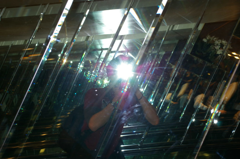 "Benjamin Von Wong – 2007  ""Well, I found a second set of mirrors… on another escalator haha. Theres a nice big flash hiding my head but I thought it'd make a cool effect on the metal parts  """