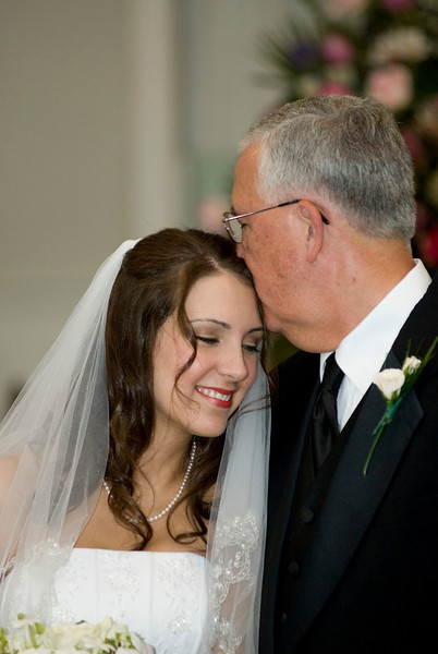 Package 2 $2000 <br /> Coverage of wedding day (up to 4 hours), a Deluxe 8x8 album, a DVD slideshow, images will be hosted on my web site for 6 months for sharing and ordering.