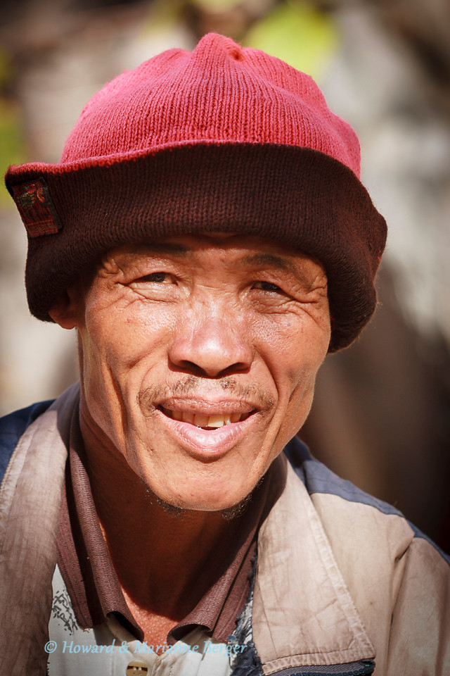 """<h2>Heard the story about the goatherder & the academic?</h2>This  San guide, Xontae Xhao, also taught us a great deal about rock paintings and his life growing up in the Tsodilo Hills, a world heritage site in Botswana.  But this story is about another man, a goatherder in Namibia. We were travelling along a very stony road through the mountains, on the way to Sossiusvlei, when  i heard an ominous flapping noise. Yes, we had a very flat tire. In those days I changed the tire, whereas now I would first try to plug the puncture. So I put the car in gear, pulled the handbrake, and firmly placed large stones at the other 3 wheels to prevent rolling. I then raised the car with its standard  jack. After removing the tire I placed it under the chassis next to the hub in case the car tilted onto its side.   <i>Now the problems started.</i> The road inclined from left to right  & I could not get the much larger inflated tire onto the hub, even with the jack fully extended. Priding myself on years of logical thought(?), I reasoned out my strategy. First try to make the tire smaller by delating it! Of course this was the first stupid move. A compliant balloon will collapse from external air pressure if you let the air out, but not a rigid rubber tire unless the weight of the car is pushing down on it. So I thought my next logical step was to raise the car even higher using our balloon exhaust jack. The car rapidly went up high enough but as I broke into a proud smile it tilted over, luckily not crashing onto the hub due to the support of the flat tire under the chassis (one point to me!).  I was now scared and decided to put the flat tire back on, drive to a level bit of road and change the tire. Luckily an old goat herder with a log stick approached with about 50 goats. He climbed over the barbed wire fence and listened patiently to my plan in my broken Afrikaans. He then said """"nee baas"""" and took the wheel spanner and dug a hole under the hub to make more room for the wheel."""