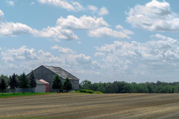 barn, field, and sky