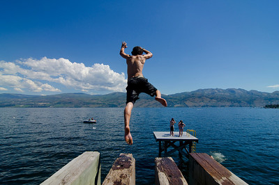 Splashing into Okanagan Lake near Gelatly Bay, West Kelowna, in the Thompson Okanagan region of British Columbia, Canada