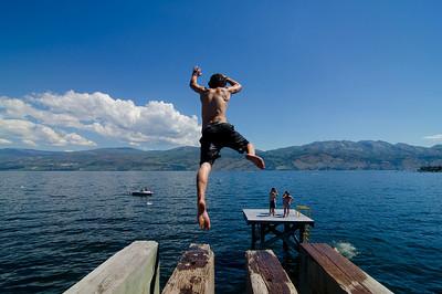 Splashing into Okanagan Lake near Gelatly Bay, West Kelowna, in the Thompson Okanagan region of British Columbia, Canada