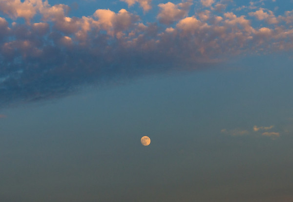 Supermoon in sunset clouds