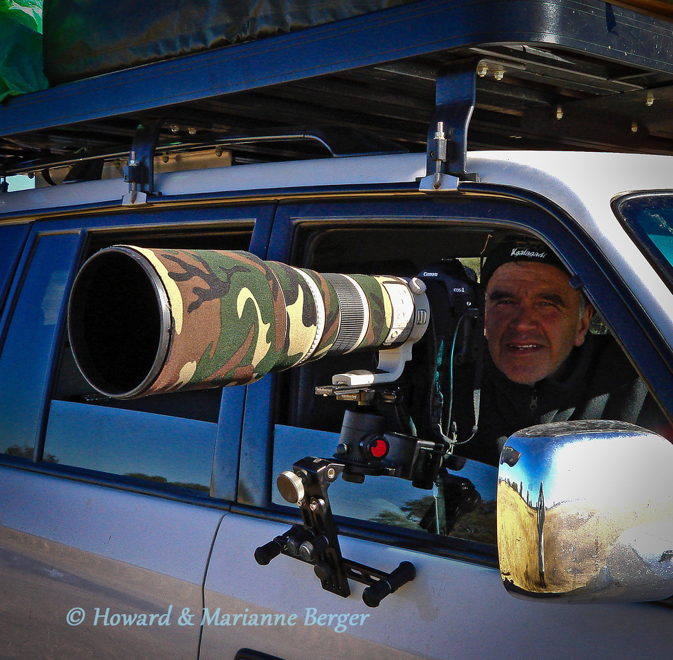 <h2>Beans, rice and metal </h2> Many use a bean bag when shooting from a car window.  I prefer to use a window mount but have replaced the ball head with a Wimberley II gimbal because of its much smoother panning, Also ability to adjust the gimbal's paltform height allows a lower window i.e.camera postion ( than shown than shown in photo) and this increases stability. We have had to add in a homemade spacer between window mount and gimbal to allow complete rotation of camera and lens, as adjustment knob was hitting window glass (thanks to Eric Pretorius at 4x4 Megaworld in Uppington, SA) The advantage of the bean bag is cheap, light, and quickly set up in rapid response moments. But friction can alter your focus rings position as you move the lens around. But for me the main reason is that, when waiting up to an hour to capture a bird taking off, I can set up my composition, and then wait, looking thru the window, with remote in hand( see discussion below).  Many failures and some successes are both accepted with a smile and the challenge enjoyed.  I like the Kirk window mount (shown), because it securely clamped to the window and rests on the door frame (as shown). But you need a square window opening, and there is a little back & forth movement of the glass.In  South Africa the Camstedi window mount, which rests directly on the door frame without a clamp, is very popular