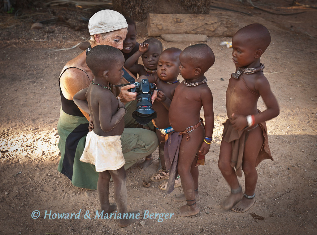 """<h2>May I take a photo? </h2>After obtaining permission from adults selling local products Marianne took pictures of the Himba children. They were intrigued by the results.   The problem of obtaining permission is that it often induces stiff posed pictures. We are also still unsure what """"permission""""  is when one cannot really communicate with so many of the most interesting subjects"""