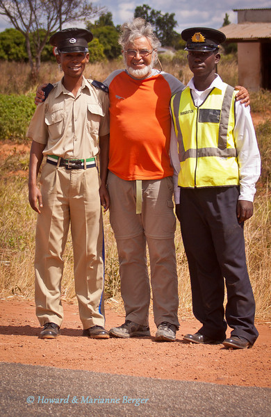 "<h2>Making new friends at road blocks</h2> In Africa etiquette demands that you always first say hello and enquire ""how are you"" before asking for help or information. Even though the main conversation will usually be carried out in english it is very helpful to learn the basic terms for greetings and farewells in the home tongue. The warm response this elicits makes all the effort worthwhile. Learning the vocabulary as one passes from one area to another gets difficult at times as each country has many dialects. However we always try to learn the basic terms of the main dialect. This is not easy at our age! So I keep a small notebook with the essential phrases in the driver's door pocket. The basic phrases are given at the back of all the excellent travel guides. You will be surprised how starting an encounter with a stern policemen at a road block with a few mispronounced words in their own language will melt hearts and trigger large smiles.  Also always remove your sunglasses, turn off the radio, and dont cross the line at the stop sign until signalled to go on. They are very strict about this last point in Namibia."