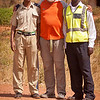 """<h2>Making new friends at road blocks</h2> In Africa etiquette demands that you always first say hello and enquire """"how are you"""" before asking for help or information. Even though the main conversation will usually be carried out in english it is very helpful to learn the basic terms for greetings and farewells in the home tongue. The warm response this elicits makes all the effort worthwhile. Learning the vocabulary as one passes from one area to another gets difficult at times as each country has many dialects. However we always try to learn the basic terms of the main dialect. This is not easy at our age! So I keep a small notebook with the essential phrases in the driver's door pocket. The basic phrases are given at the back of all the excellent travel guides. You will be surprised how starting an encounter with a stern policemen at a road block with a few mispronounced words in their own language will melt hearts and trigger large smiles.  Also always remove your sunglasses, turn off the radio, and dont cross the line at the stop sign until signalled to go on. They are very strict about this last point in Namibia."""