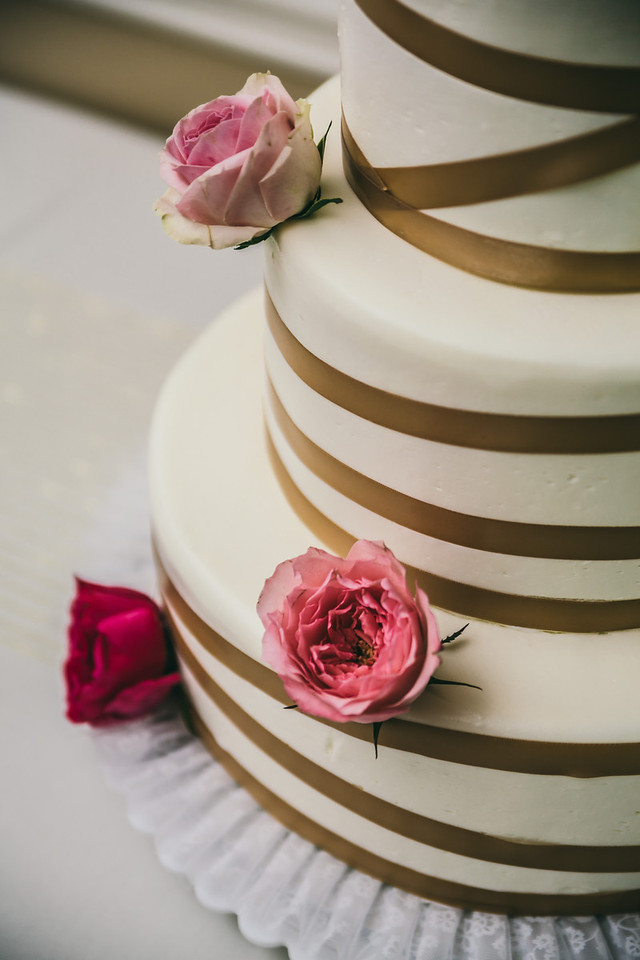 wedding cake with gold ribbons