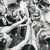 Friends sing to the bride on the dance floor at Skaneateles Country Club.