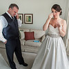 A bride and her father cry as they talk about getting married.