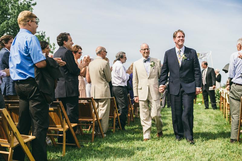 Same sex couple  smile as they are married at Hurd Orchard in Holley, NY.