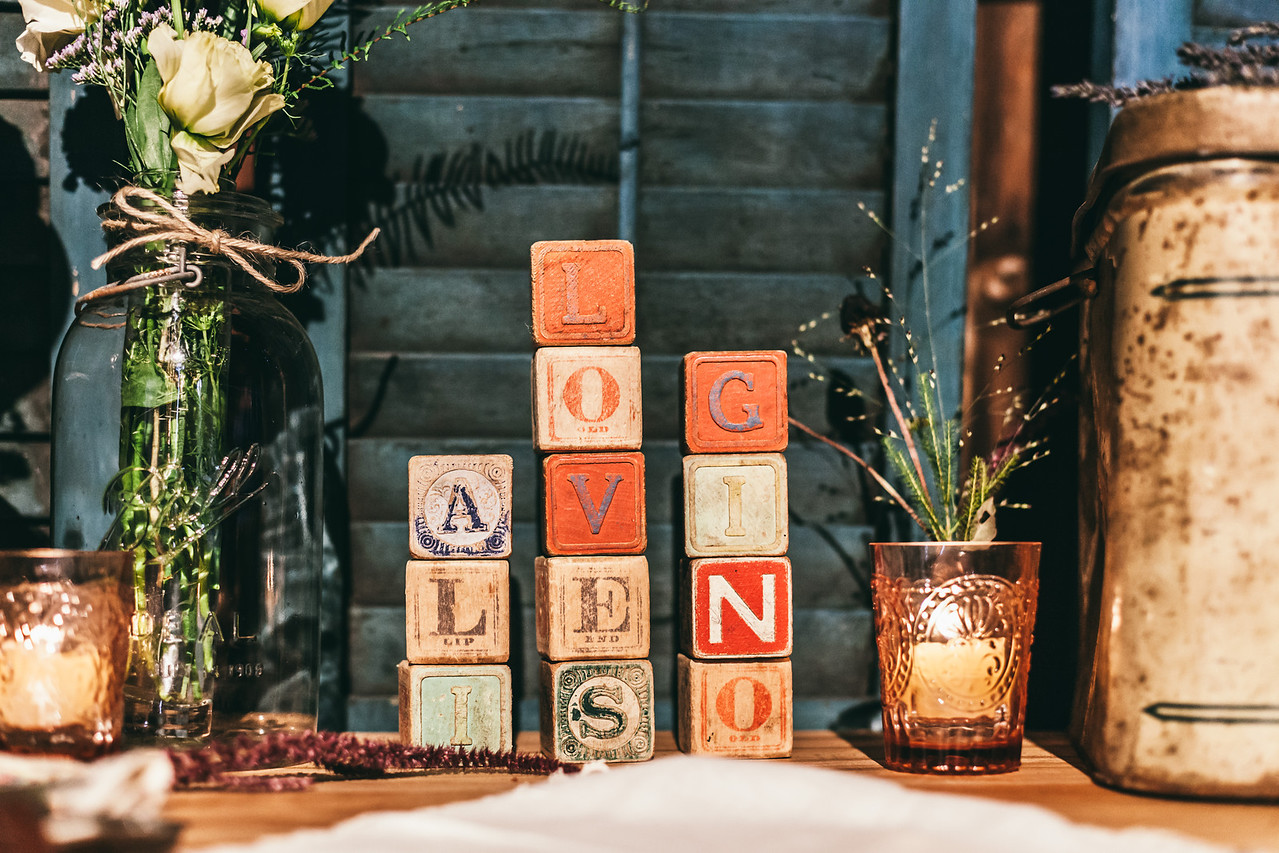 Playful antique blocks at a private Pittsford, NY, farm wedding.